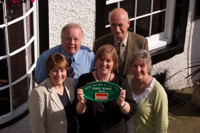 Caroline Holmes, Jim Bownass, Lorraine Brierley, Joen Holmes and Denise Park with the Cumbrian winner's plaque
